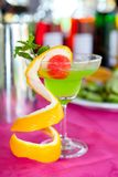 Green Juice with watermelon ball and topping orange ingredient ; stock photo