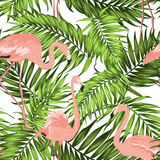 Green jungle palm leaves pink flamingos pattern Royalty Free Stock Image