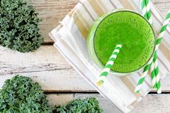 Green kale smoothie with straws overhead view Royalty Free Stock Photography