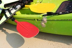 Green kayak. With life-jacket and paddles Stock Photography