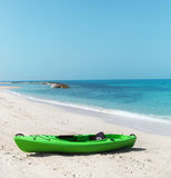 Green kayak on the beach Royalty Free Stock Images