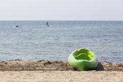 Green kayak in the beach Stock Photography