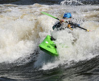 Green Kayak Blue Helmet royalty free stock photo