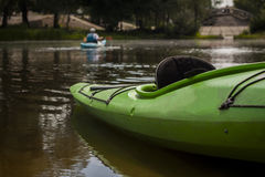 Green kayak on the river bank. Empty Royalty Free Stock Image