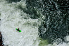 Green Kayak in White Water Stock Images