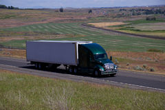 Green Kenworth Semi-Truck / White Blank Trailer Royalty Free Stock Photo