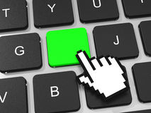 Green key and hand cursor on keyboard of laptop computer. Stock Images