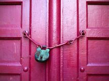 Green Key on Red Wood Door Stock Photography