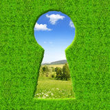 Green keyhole. On the background spring landscape Royalty Free Stock Photos