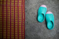 Green kid shoes on cement ground Stock Photos