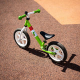 Green kids bike. Children's Bicycle green color on the site Royalty Free Stock Image