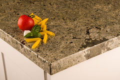 Green kitchen countertop with food on it. Granite counter concept. stock photos