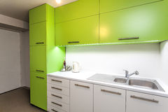 Green kitchen furniture Stock Photography