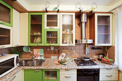 Green Kitchen interior with many utensils. And vegetables royalty free stock photos