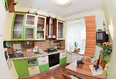 Green Kitchen interior with many utensils. And window, fisheye View royalty free stock photography