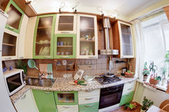 Green Kitchen interior with many utensils. And window, fisheye View stock images