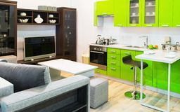Green kitchen and room clean interior design. Modern light green kitchen and room clean interior design stock photography