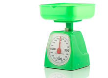 Green kitchen weighing scale for food ingredients Royalty Free Stock Image