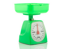 Green kitchen weighing scale for food ingredients Royalty Free Stock Images