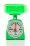Green kitchen weighing scale for food ingredients Stock Photos