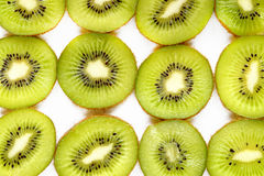 Green kiwi cut background Royalty Free Stock Images