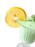 Green kiwi ice-cream. With lemon on white stock photos
