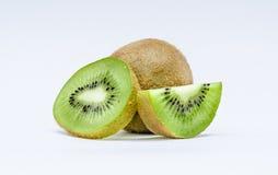 Green kiwi. Kiwis in a white background royalty free stock image