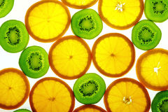 Green kiwi and orange slices Stock Photography