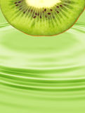 Green kiwi slice taken closeup on green abstract background. Royalty Free Stock Photography