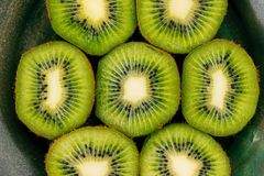 Green kiwi slices in a bowl. Royalty Free Stock Photography