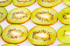 Green kiwi slices wallpaper Stock Photos