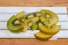 Green kiwi. Yellow Kiwi Stock Images