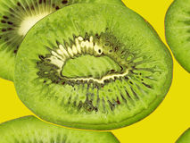 Green kiwi on a yellow taken closeup.Food backround. Stock Photo