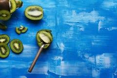 Kiwis in blue background textured Stock Photos
