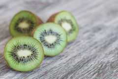 Green kiwis on the wooden background. Soft focus background royalty free stock photography