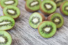 Green kiwis on the wooden background. Soft focus background royalty free stock photos