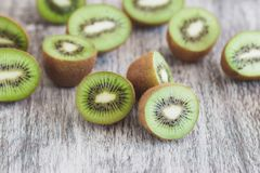 Green kiwis on the wooden background. Soft focus background stock photography