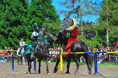 Green knight deflects the red knight's hit Royalty Free Stock Image