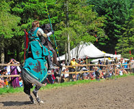 Green knight prepares for the spear throw. Stock Photos