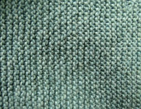 Green knitted background texture Stock Images