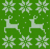 Green Knitted deers sweater in Norwegian style. Knitted Scandinavian ornament. Vector seamless Christmas sweater pattern. Stock Photography