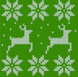 Green Knitted deers sweater in Norwegian style. Stock Photo