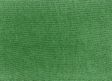 Green knitted material texture. Stock Photos
