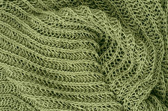 Green knitted pullover background Stock Photos