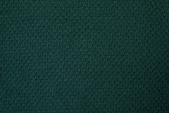 Green knitted texture, top view stock photo