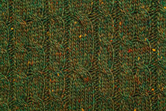 Green knitted textured background with a pattern closeup Royalty Free Stock Images