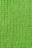 Green knitted wool close up. Usable as background knitting or textile related projects Stock Image