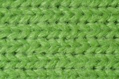 Green knitted wool close up. Usable as background knitting or textile related projects Royalty Free Stock Photography