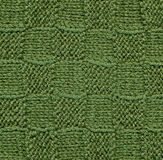 Green knitted wool pattern. Royalty Free Stock Image