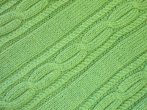 Green knitting. Textures suitable as background Royalty Free Stock Photos